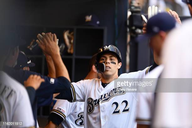 Christian Yelich of the Milwaukee Brewers is congratulated by teammates following a solo home run against the San Francisco Giants during the sixth...