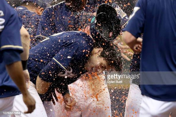 Christian Yelich of the Milwaukee Brewers is dunked with Gatorade after hitting a fielder's choice to beat the Chicago Cubs 43 at Miller Park on...