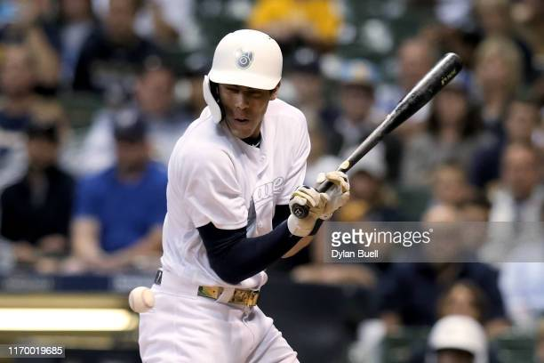 Christian Yelich of the Milwaukee Brewers is hit by a pitch in the seventh inning against the Arizona Diamondbacks at Miller Park on August 24, 2019...