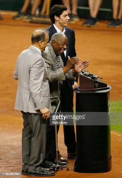 Christian Yelich of the Milwaukee Brewers is presented the Hank Aaron award by Joe Torre and Hank Aaron prior to Game Two of the 2019 World Series...