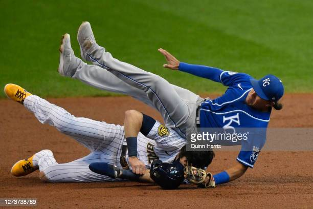 Christian Yelich of the Milwaukee Brewers is tagged out in the first inning against Nicky Lopez of the Kansas City Royals at Miller Park on September...