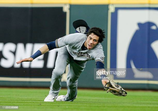Christian Yelich of the Milwaukee Brewers makes a diving catch on a line drive by Jake Marisnick of the Houston Astros in the third inning at Minute...