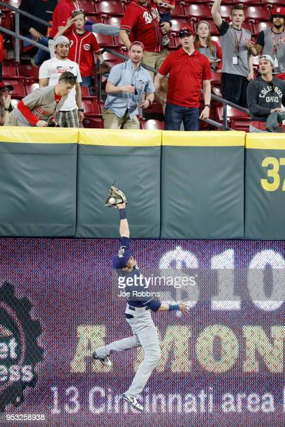 Christian Yelich of the Milwaukee Brewers makes a leaping catch in front of the wall in left field in the sixth inning of a game against the...
