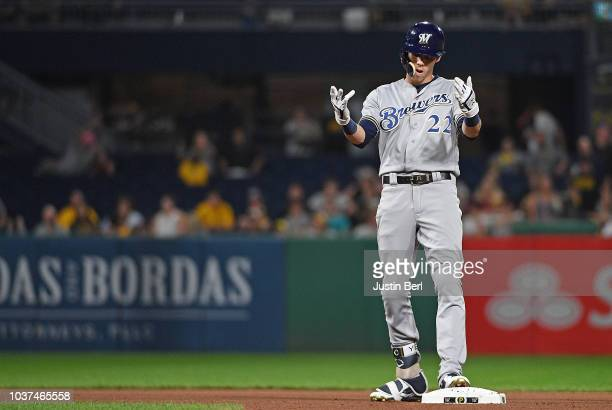 Christian Yelich of the Milwaukee Brewers reacts after hitting a double in the fourth inning during the game against the Pittsburgh Pirates at PNC...