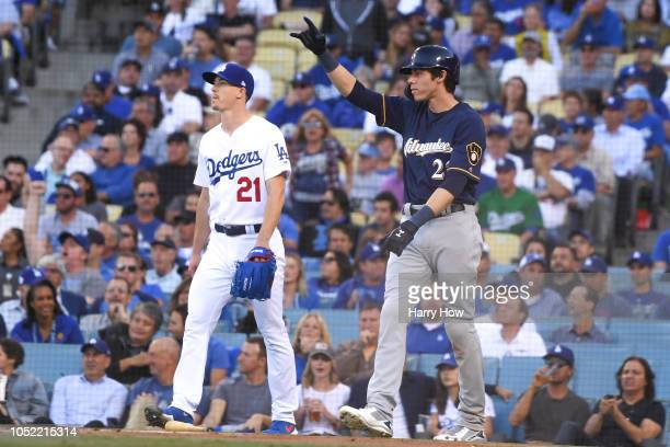 Christian Yelich of the Milwaukee Brewers reacts after scoring a run in the first inning off a double allowed by Walker Buehler of the Los Angeles...