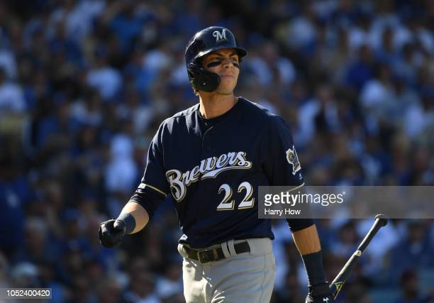 Christian Yelich of the Milwaukee Brewers reacts after striking out swinging during the third inning of Game Five of the National League Championship...