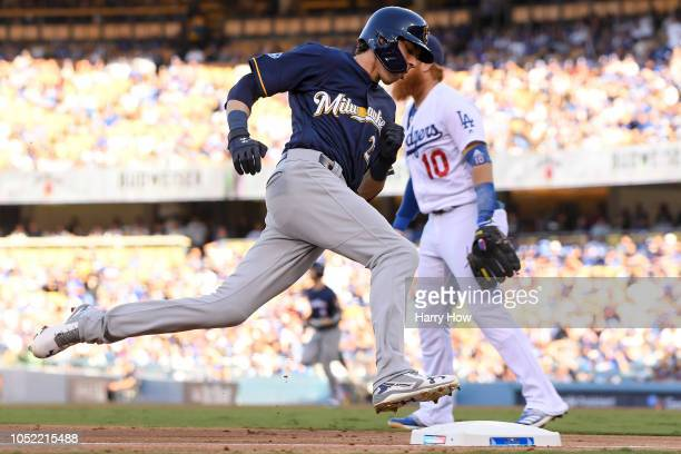 Christian Yelich of the Milwaukee Brewers rounds third base to score on a Ryan Braun RBI double in the first inning against the Los Angeles Dodgers...