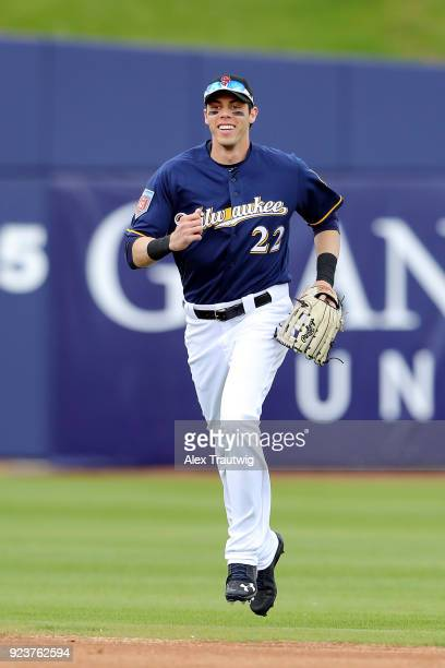 Christian Yelich of the Milwaukee Brewers runs back to the dugout after making a catch during a game against the Chicago Cubs on Friday February 23...