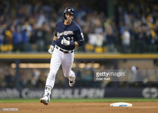 Christian Yelich of the Milwaukee Brewers runs the bases after hitting a homerun to score Lorenzo Cain in the third inning of Game One of the...