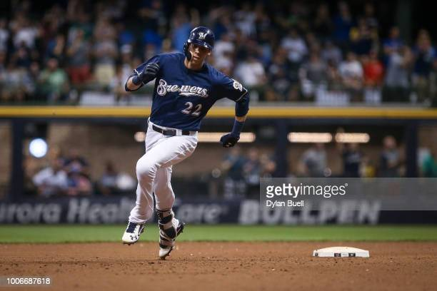 Christian Yelich of the Milwaukee Brewers runs to third base for a triple in the sixth inning against the Washington Nationals at Miller Park on July...