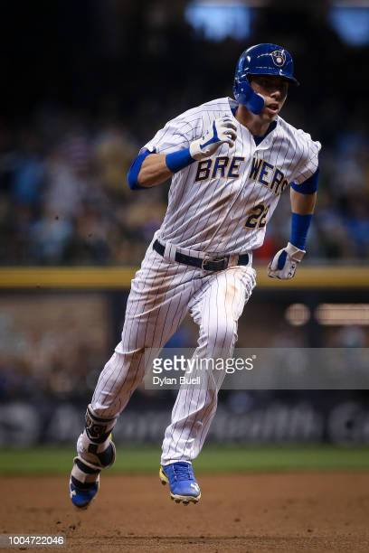 Christian Yelich of the Milwaukee Brewers runs to third base in the fifth inning against the Los Angeles Dodgers at Miller Park on July 20 2018 in...