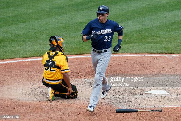 Christian Yelich of the Milwaukee Brewers scores on a RBI single in the sixth inning against the Pittsburgh Pirates at PNC Park on July 15 2018 in...