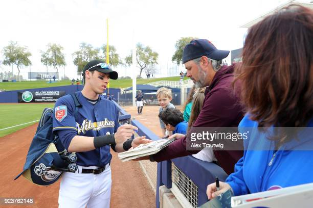 Christian Yelich of the Milwaukee Brewers signs autographs prior to a game against the Chicago Cubs on Friday February 23 2018 at the Maryvale...