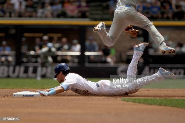 Christian Yelich of the Milwaukee Brewers slides into second base for a steal past JP Crawford of the Philadelphia Phillies in the first inning at...