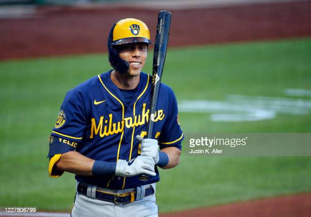 Christian Yelich of the Milwaukee Brewers smiles after striking out looking in the first inning against the Pittsburgh Pirates during Opening Day at...
