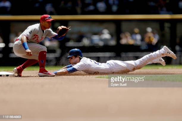 Christian Yelich of the Milwaukee Brewers steals second base past Cesar Hernandez of the Philadelphia Phillies in the first inning at Miller Park on...
