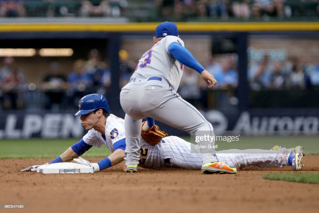 Christian Yelich #22 of the Milwaukee Brewers steals second base past Asdrubal Cabrera #13 of the New York Mets in the third inning at Miller Park on May 25, 2018 in Milwaukee, Wisconsin.