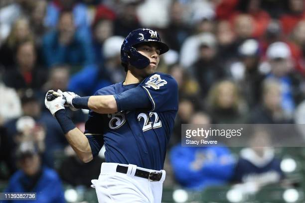 Christian Yelich of the Milwaukee Brewers swings at a pitch during the eighth inning of a game against the St Louis Cardinals at Miller Park on March...