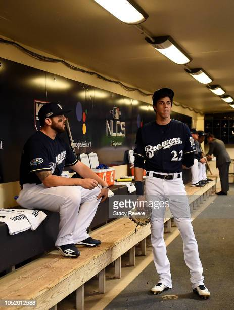 Christian Yelich of the Milwaukee Brewers talks in the dugout prior to Game One of the National League Championship Series against the Los Angeles...