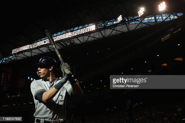 Christian Yelich of the Milwaukee Brewers warms up ondeck during the first inning of the MLB game against the Arizona Diamondbacks at Chase Field on...