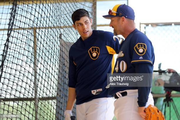 Christian Yelich speaks with coach Jason Lane of the Milwaukee Brewers during workouts on Wednesday February 21 2018 at the Maryvale Baseball Park in...
