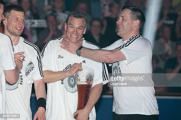 Christian Zeitz and Head coach Alfred Gislasonof Kiel celebrate after winning the DKB HBL Bundesliga match between THW Kiel and Fuechse Berlin on May...