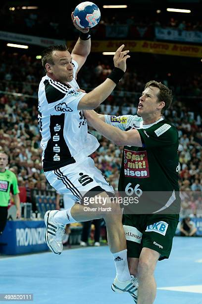Christian Zeitz of Kiel challenges for the ball with Sven Soeren Christophersen of Berlin during the DKB HBL Bundesliga match between THW Kiel and...