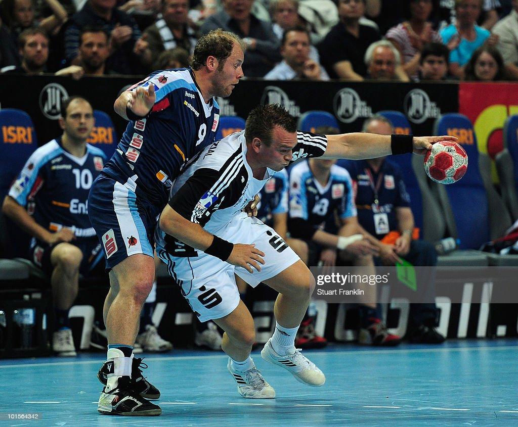 Christian Zeitz of Kiel is challenged byFrank Ettwein of Balingen during the Toyota Handball bundesliga match between THW Kiel and HBW Balingen-Weilstetten at the Sparkassen Arena on June 2, 2010 in Kiel, Germany.