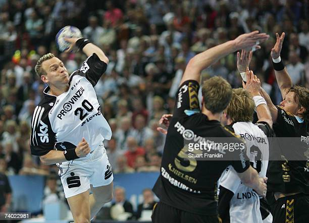 Christian Zeitz of Kiel throws a goal during the Champions League second leg final between THW Kiel and SG Flensburg Handewitt at the Ostsee Hall on...