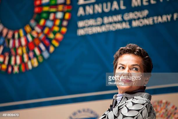 Christiana Figueres executive secretary of the United Nations framework convention on climate change listens during a panel discussion on climate...