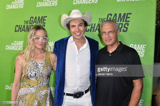 Christiana Wyly Kimbal Musk and Louie Psihoyos arrive at the LA Premiere of 'The Game Changers' at ArcLight Hollywood on September 04 2019 in...