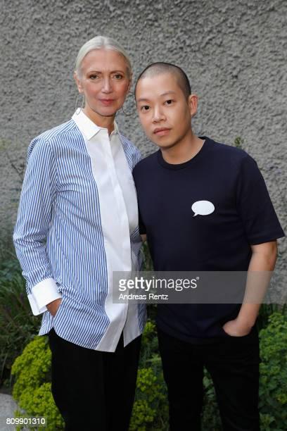 Christiane Arp and Jason Wu arrive to the Hugo Boss presentation during 'Der Berliner Mode Salon' Spring/Summer 2018 at St. Agnes Church on July 6,...