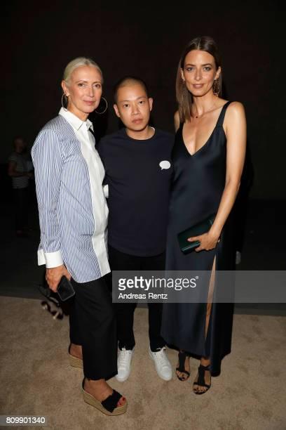 Christiane Arp Jason Wu and Eva Padberg pose after the Hugo Boss presentation during 'Der Berliner Mode Salon' Spring/Summer 2018 at St Agnes Church...