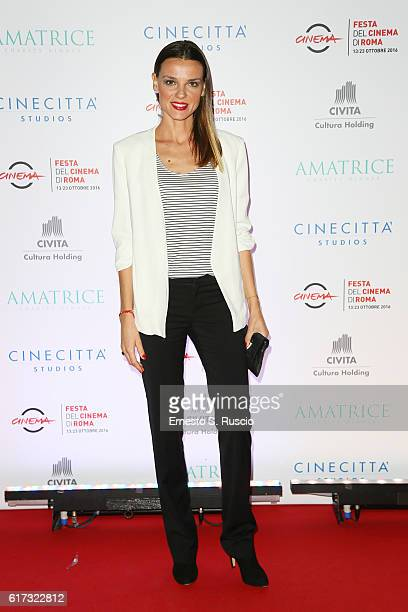 Christiane Filangieri walks a red carpet at the charity dinner for Amatrice during the 11th Rome Film Festival at Auditorium Parco Della Musica on...