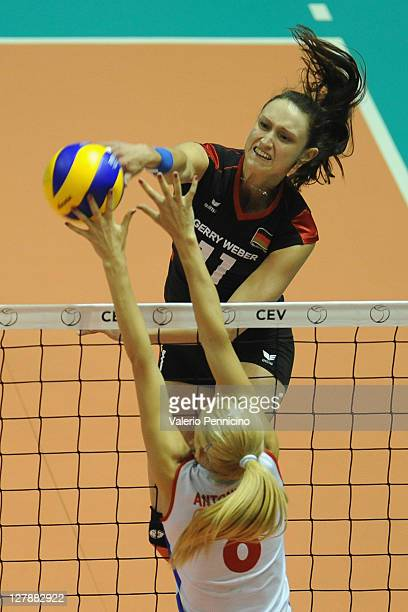 Christiane Furst of Germany smashes as Ana Antonijevic of Serbia blocks during the women's Volleyball European Championship final match between...