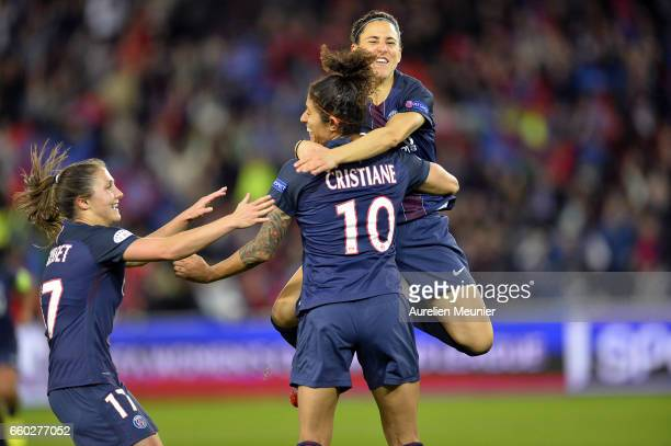 Christiane of Paris Saint Germain is congratulated by teammates after scoring during the Champions League match between Paris Saint Germain and...