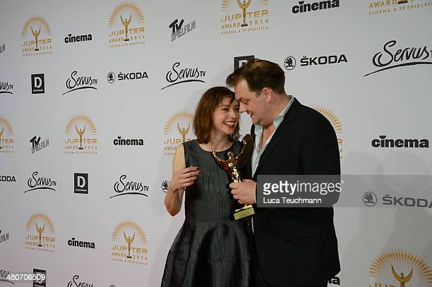 Christiane Paul and Charly Huebner present her award 'Jupiter Award 2014' at Cafe Moskau on March 26 2014 in Berlin Germany