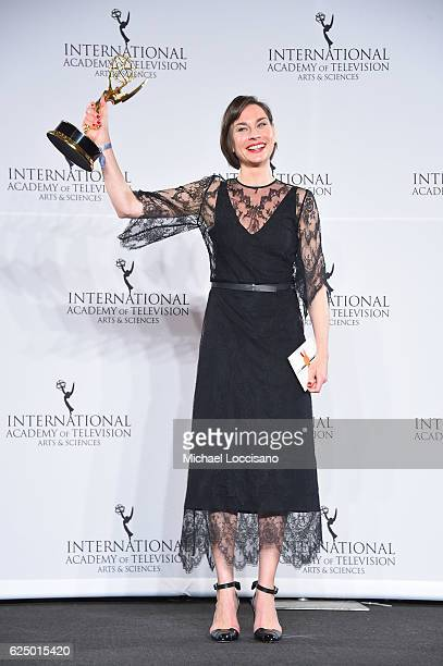 Christiane Paul poses with the Best Performance by an Actress award in the press room during the 44th International Emmy Awards at New York Hilton on...