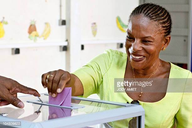 Christiane Taubira deputy and supporter of the 'Yes' casts his vote in the polling station of Cayenne on the French South American territory of...