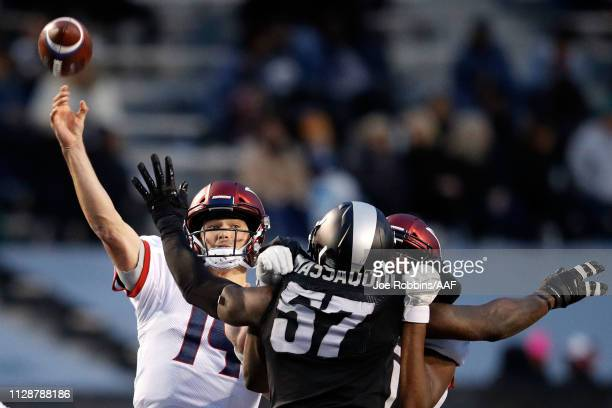 ChristianHackenberg of Memphis Express is pressured by JonathanMassaquoi of Birmingham Iron during an Alliance of American Football game at Legion...