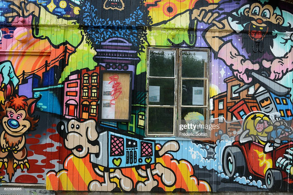 Christiania, also known as Freetown Christiania (Danish: Fristaden Christiania or Staden), is a self-proclaimed autonomous neighborhood of about 850 residents, covering 34 hectares (84 acres) in the borough of Christianshavn in the Danish capital Copenhagen - mural painting - Denmark.