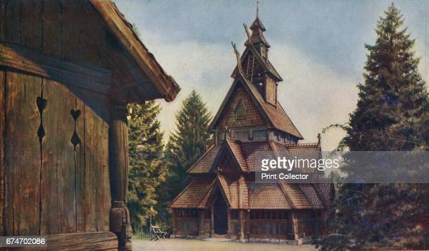 Christiania. Dragon-head gable terminals, suggesting the prows of Viking ships, and shingle roofs characterise the old wooden Stave characters in...