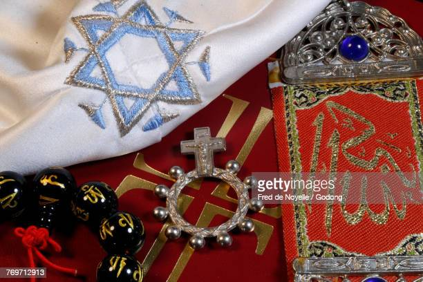 christianity, buddhism, islam and judaism. interfaith symbols : bible, kippah, allah monogram and mala.  - religious symbol stock pictures, royalty-free photos & images