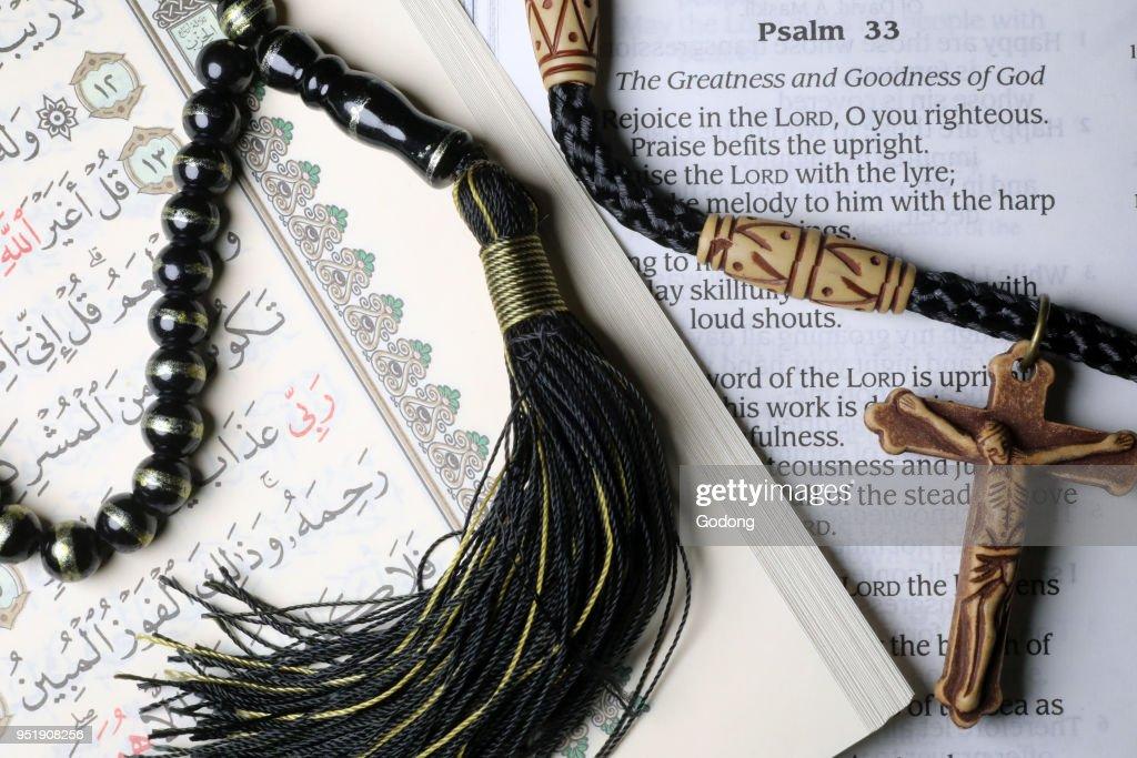 Bible And Quran Crucifix And Prayer Beads Interfaith Symbols