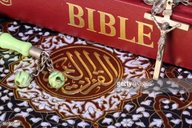 Christianity Islam 2 monotheistic religions Bible Quran Crucifix and prayer beads Interfaith symbols