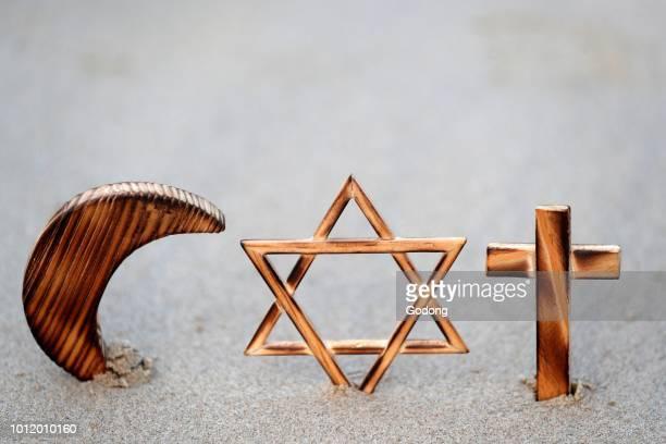Christianity Islam Judaism 3 monotheistic religions Jewish Star Cross and Crescent Interreligious symbols