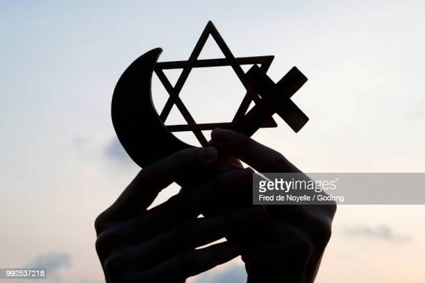 christianity, islam, judaism  3  monotheistic religions. jewish  star, cross and crescent :  interreligious symbols in hands. - christianity stock pictures, royalty-free photos & images