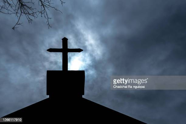 christianity religion, cross at the church of the christian faith on halloween night. - catholicism stock pictures, royalty-free photos & images