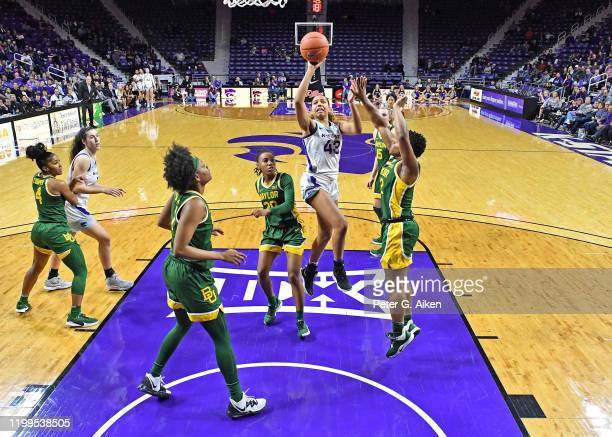 Christianna Carr of the Kansas State Wildcats puts up a shot against DiDi Richards of the Baylor Lady Bears during the second quarter on February 8,...