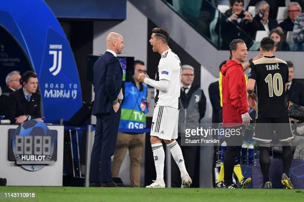 Christiano Ronaldo of Juventus celebrates scoring the first goal decided using VAR technology during the UEFA Champions League Quarter Final second...